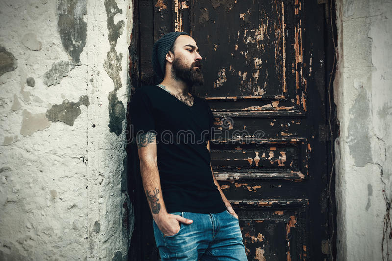 Portrait of brutal bearded man wearing blank t-shirt stock photo