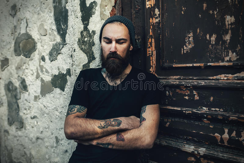Portrait of brutal bearded man wearing blank t-shirt stock photo