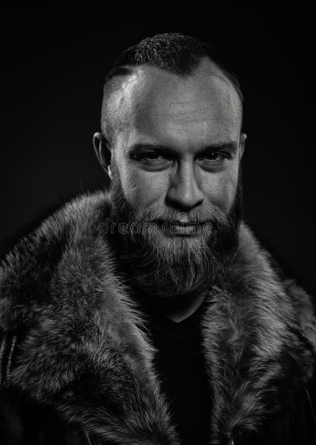 Portrait of brutal handsome smiling unshaven man royalty free stock photos
