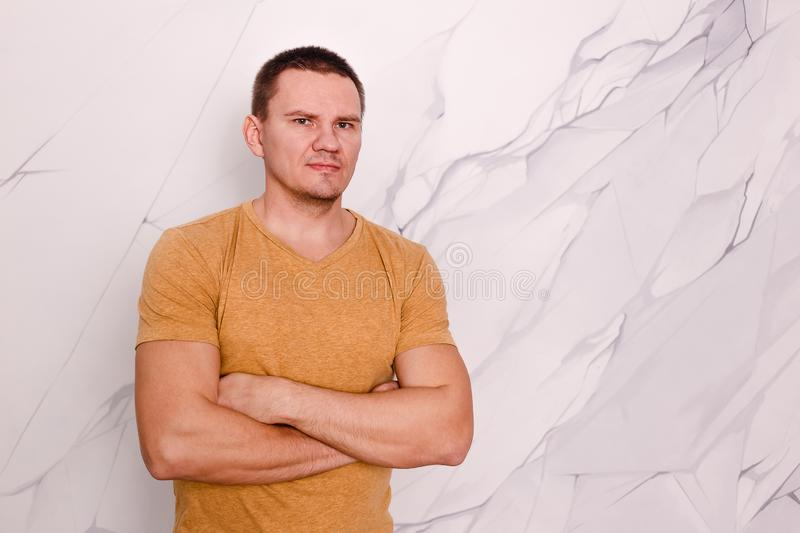 Portrait of a brutal man in a yellow T-shirt stock photos