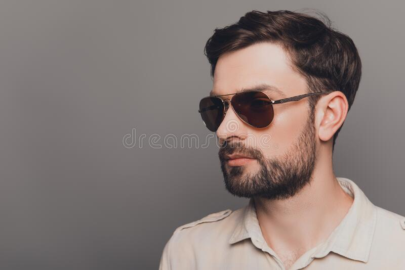 Portrait of brutal young bearded sexy man in spectacles stock photography