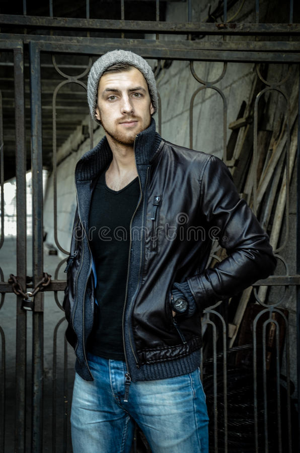Portrait of brutal young man. Bad boy concept. stock photos