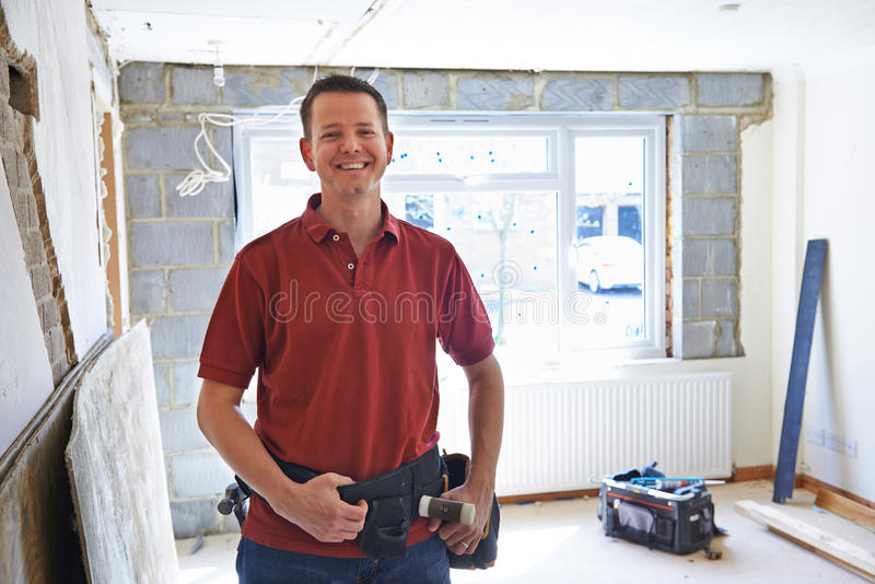 Portrait Of Builder Carrying Out Home Improvements royalty free stock image