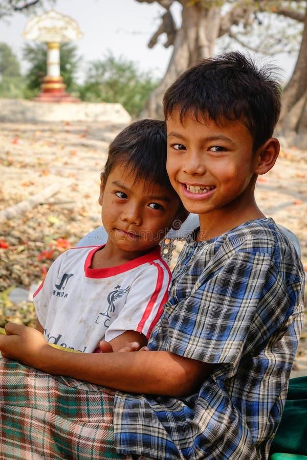 Portrait of Burmese boys in Bagan, Myanmar.  stock photo