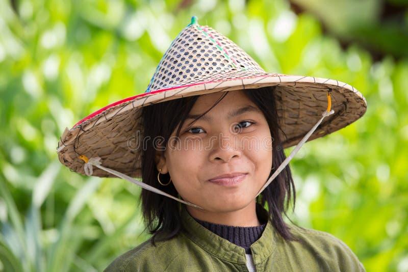 Portrait burmese girl in local market. Ngapali, Myanmar, Burma. NGAPALI, MYANMAR - JANUARY 23, 2016: Portrait burmese girl a straw hat in local market. Myanmar stock photo