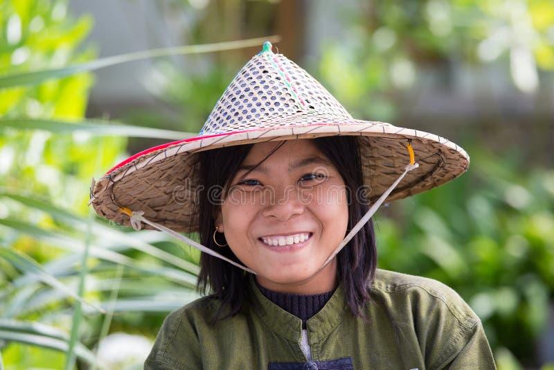 Portrait burmese girl in local market. Ngapali, Myanmar, Burma. NGAPALI, MYANMAR - JANUARY 23, 2016: Portrait burmese girl a straw hat in local market. Myanmar stock image