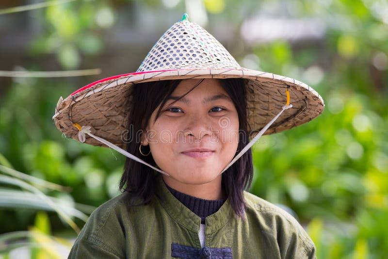 Portrait burmese girl in local market. Ngapali, Myanmar, Burma. NGAPALI, MYANMAR - JANUARY 23, 2016: Portrait burmese girl a straw hat in local market. Myanmar stock photos