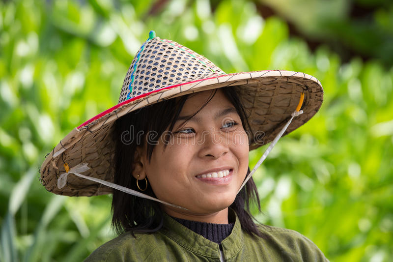 Portrait burmese girl in local market. Ngapali, Myanmar, Burma. NGAPALI, MYANMAR - JANUARY 23, 2016: Portrait burmese girl a straw hat in local market. Myanmar royalty free stock photography