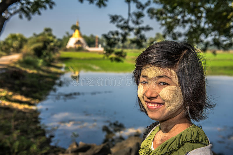 Portrait of a burmese girl with thanaka on her face royalty free stock photography