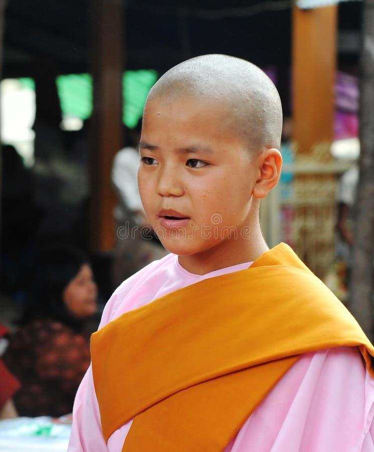 Portrait of Burmese nun at the monastery in Shan, Myanmar.  stock images