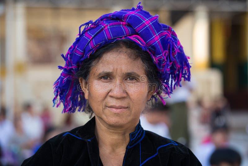 Portrait Burmese woman in the national costume. Yangon, Myanmar. YANGON, MYANMAR - FEBRUARY 01, 2016: Unidentified Burmese woman in the national costume visit royalty free stock photo