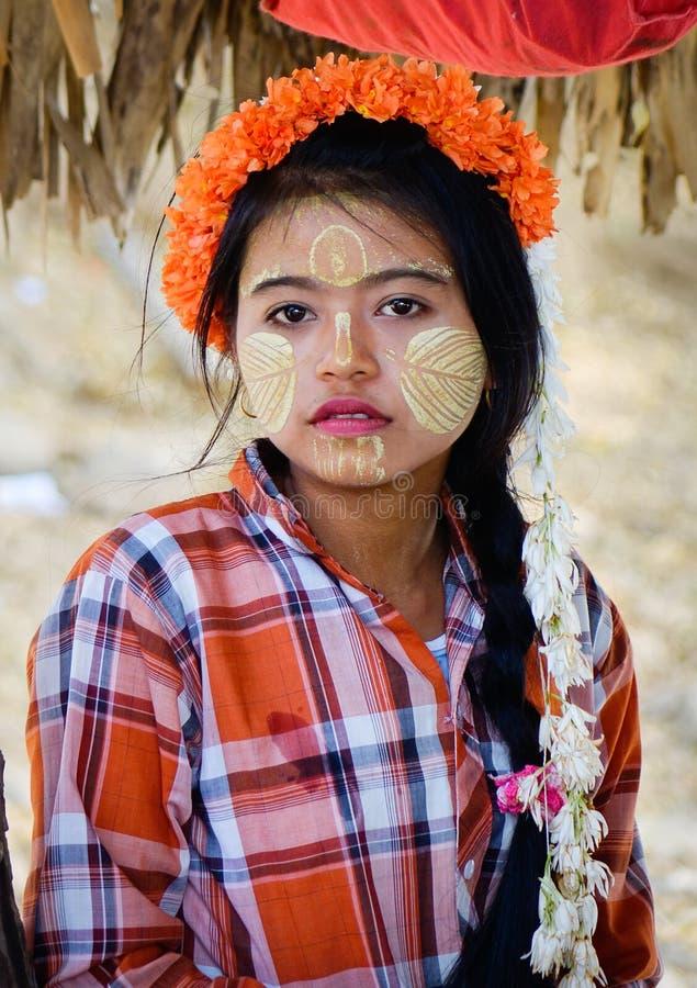 Portrait of Burmese woman on street in Bagan, Myanmar.  stock photos