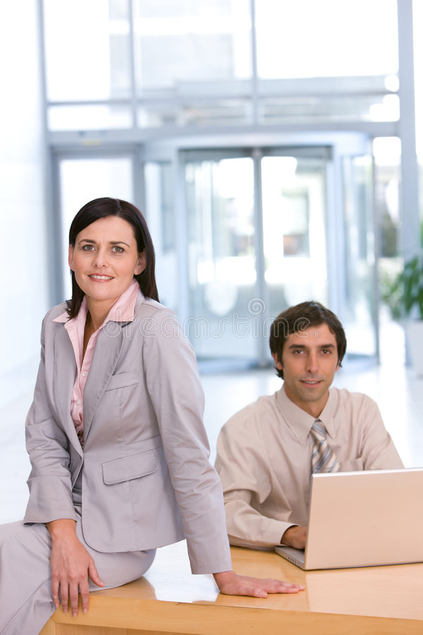 Portrait Of Business Colleagues Working On Laptop Stock Photo