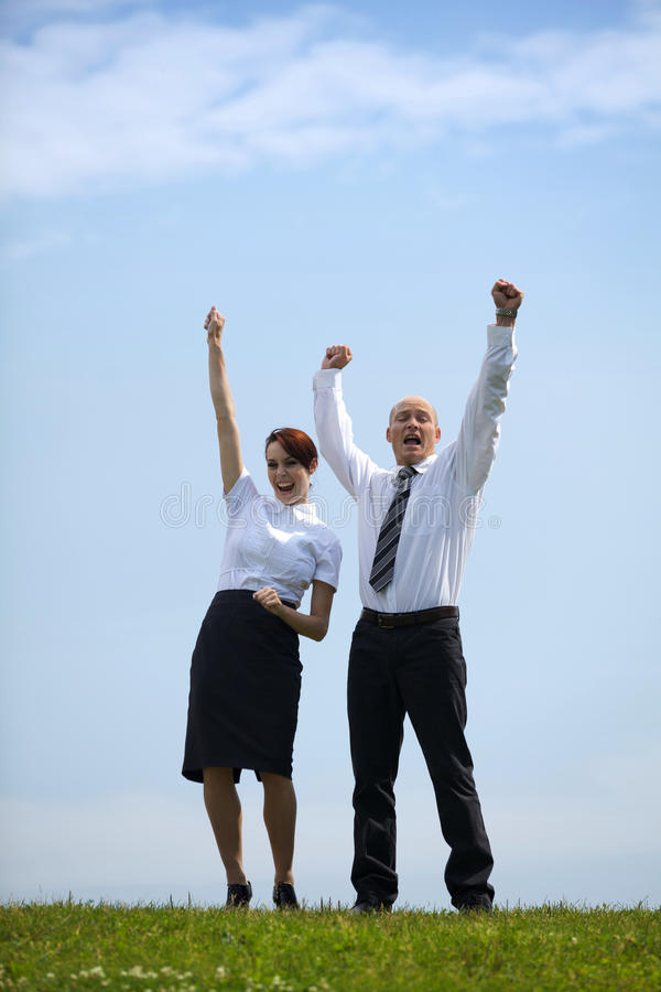 Portrait of business couple enjoying in park royalty free stock images