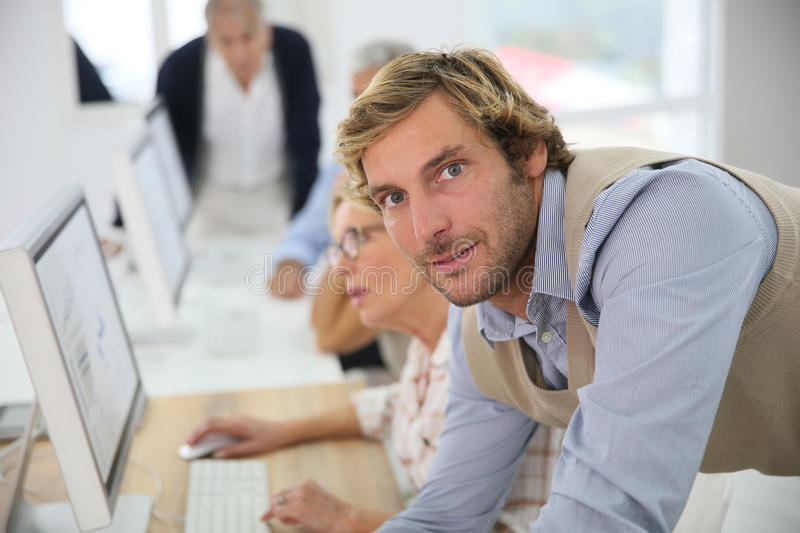 Portrait of business instructor in class. Portrait of young instructor in business class stock photos