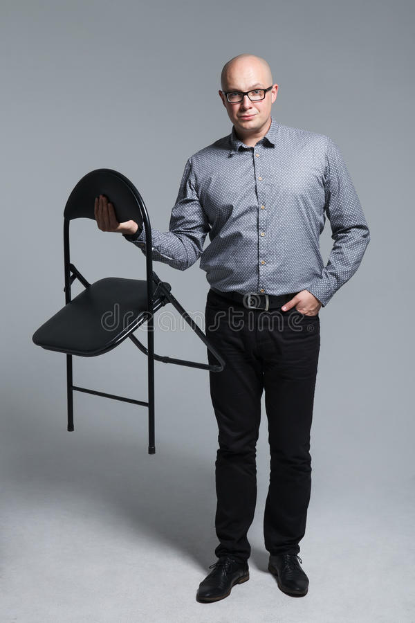 Portrait of business man with a chair royalty free stock images