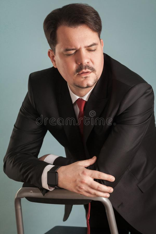 Portrait of business man, closed eyes and have unhappy look royalty free stock photography