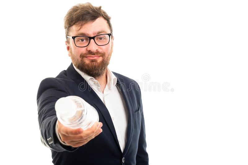 Portrait of business man handing a bottle of water stock photography