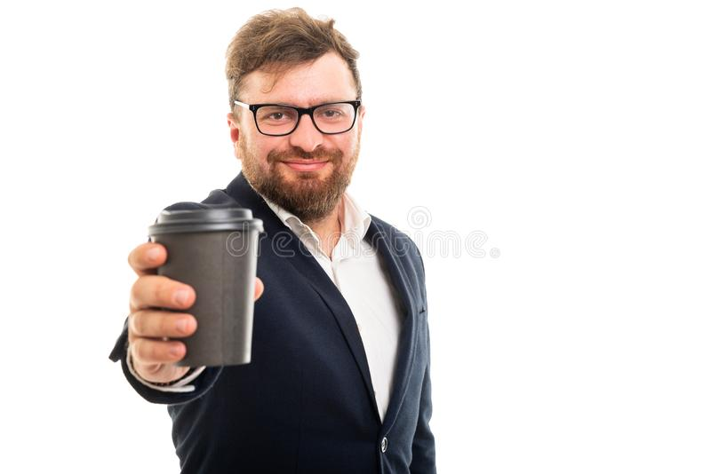 Portrait of business man handing a to go cup of coffee royalty free stock photo