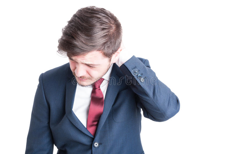 Portrait of business man having a neck or head ache royalty free stock image