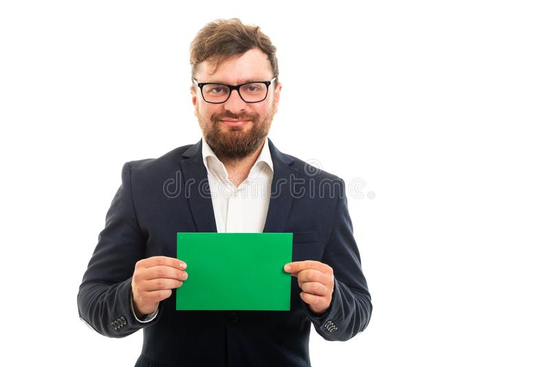 Portrait of business man holding green card board royalty free stock images