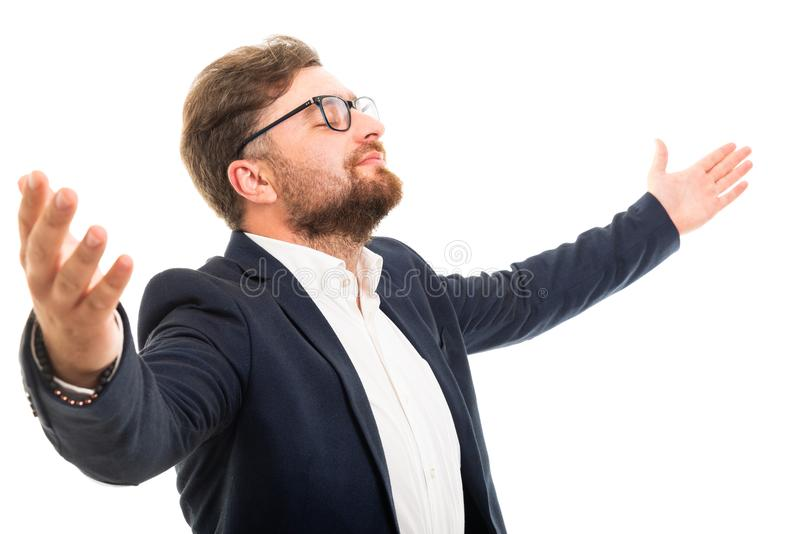 Portrait of business man with open arms and eyes closed stock images