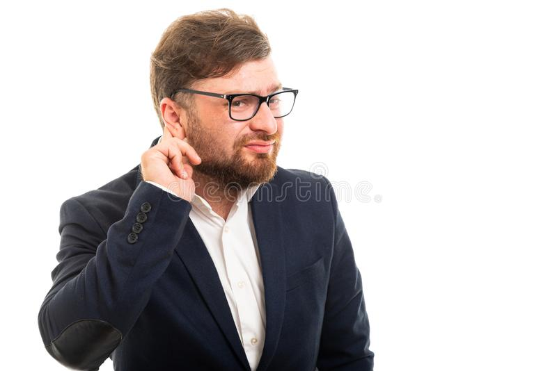 Portrait of business man showing can`t hear gesture royalty free stock photography