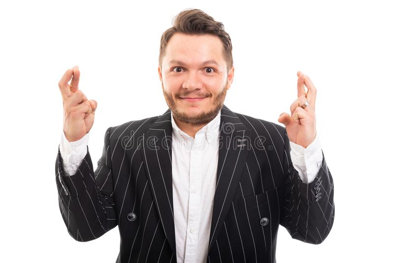 Portrait of business man showing double cross fingers gesture. Isolated on white background royalty free stock photo