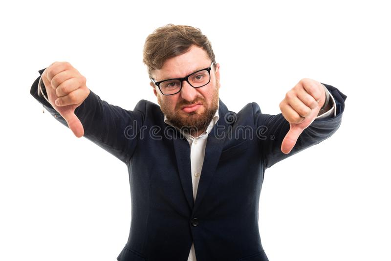 Portrait of business man showing double thumb down gesture. Isolated on white background with copyspace advertising area stock images