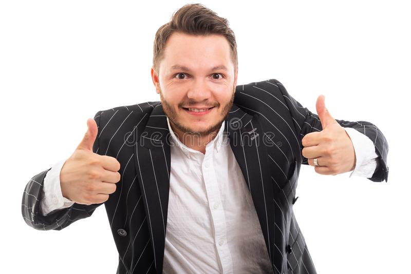Portrait of business man showing double thumb up gesture. Isolated on white background stock image
