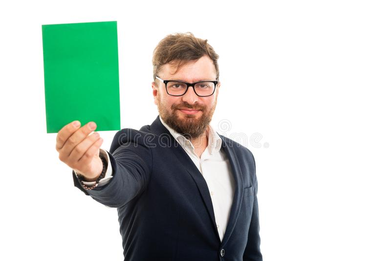 Portrait of business man showing green card board stock image