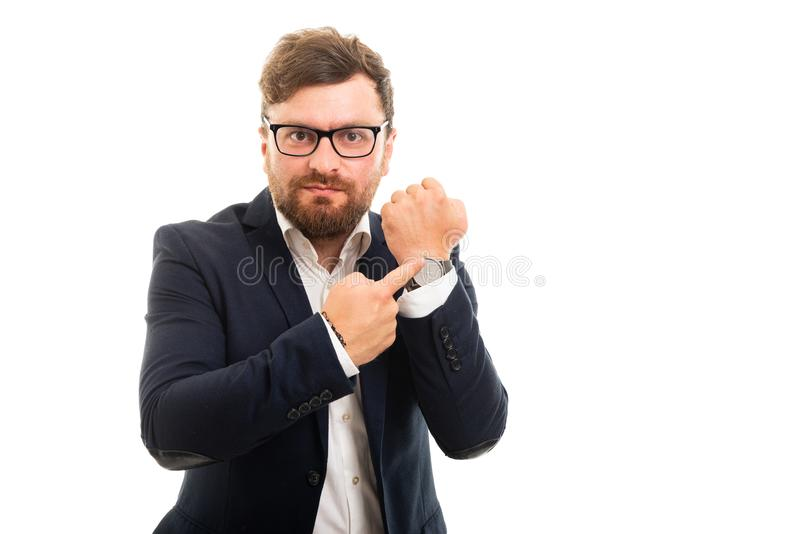Portrait of business man showing wrist watch. Isolated on white background with copyspace advertising area stock photos