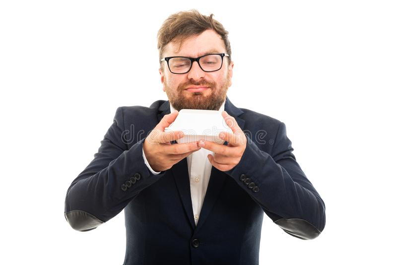 Portrait of business man smelling to go lunch box royalty free stock image