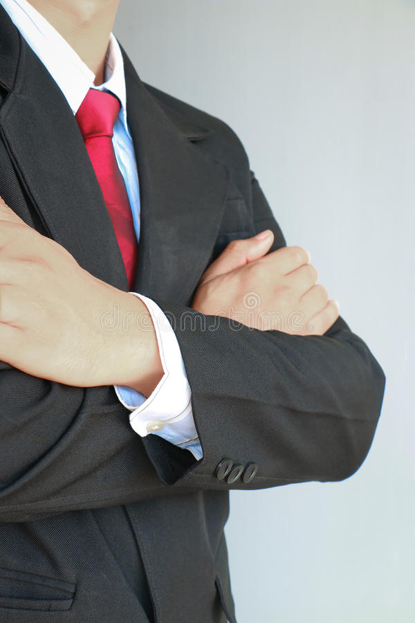 Portrait of business man in suit with red tie stock photo