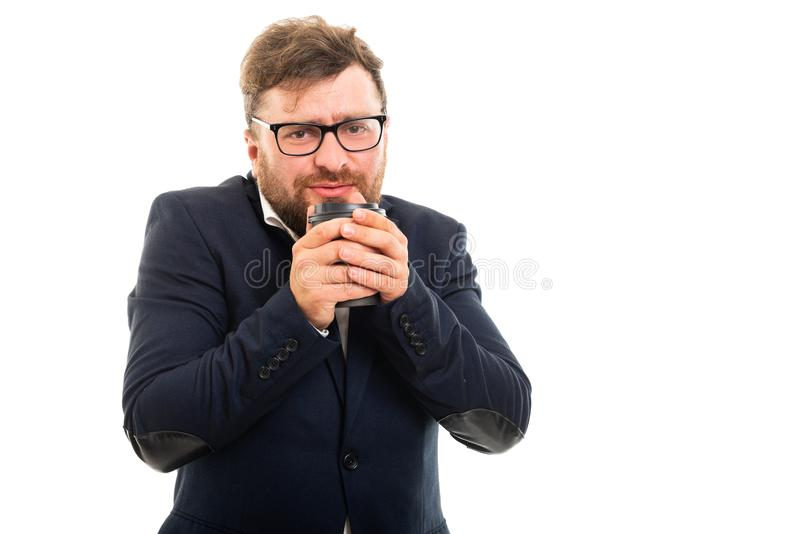 Portrait of business man warming with to go cup of coffee stock photography