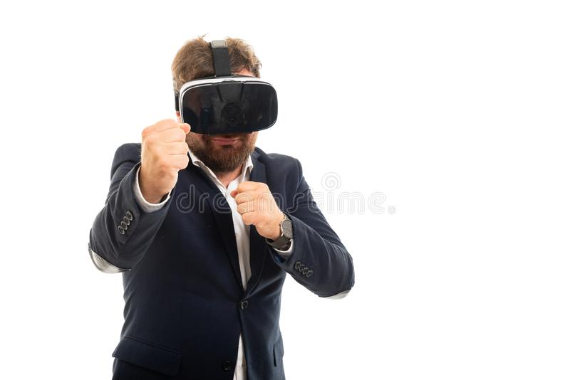 Portrait of business man wearing vr goggles showing both fists royalty free stock photography