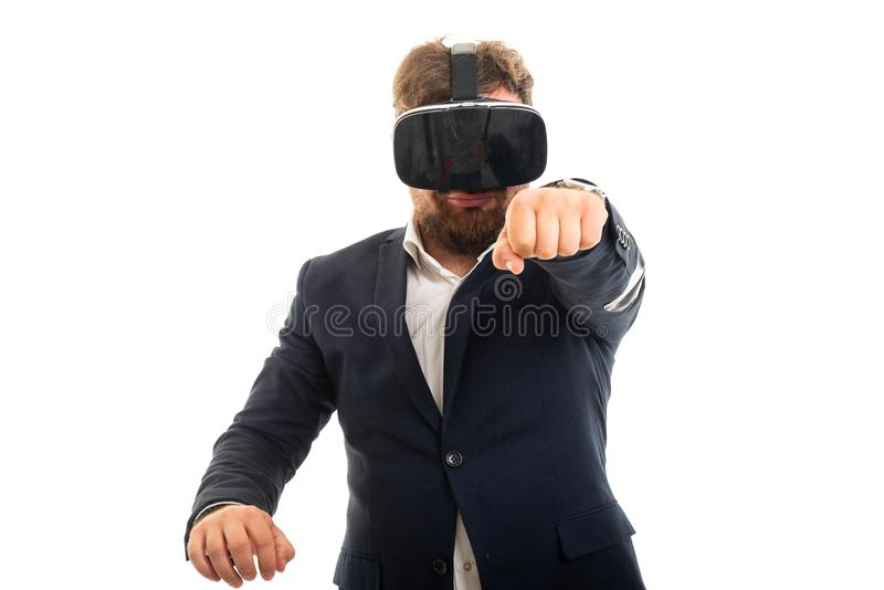 Portrait of business man wearing vr goggles and showing fist stock photo