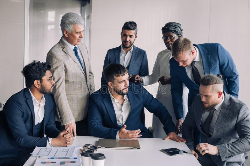 Portrait Of Business men only Meeting Around Table In Office stock photos