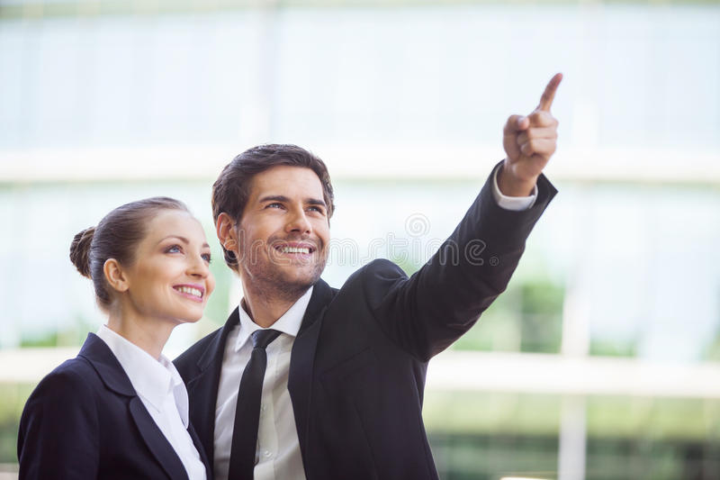 Portrait of business people standing outside. royalty free stock photos