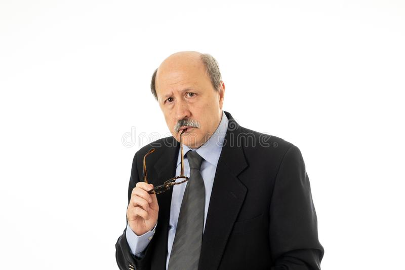 Portrait of business senior man in his 60s thinking in executive decision or next move in Work problems and retirement concept iso royalty free stock photography