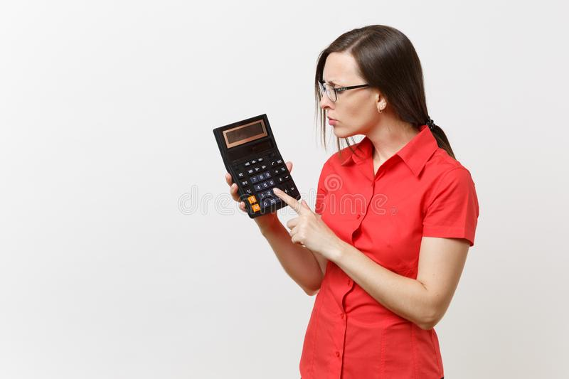 Portrait of business teacher or accountant woman in red shirt, glasses holding calculator in hands on white. Background. Education teaching in high school stock photos