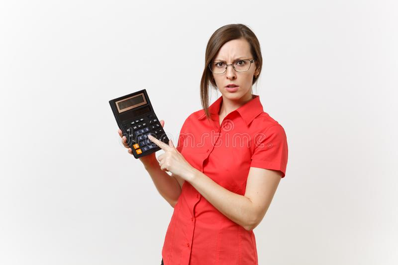 Portrait of business teacher or accountant woman in red shirt, glasses holding calculator in hands on white royalty free stock images