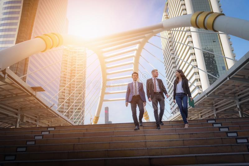 Portrait of business team climbing stairs go to a city. Business royalty free stock photography