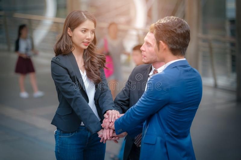 Portrait of Business team joined hands on Blurred city background. Business concept of teamwork royalty free stock images