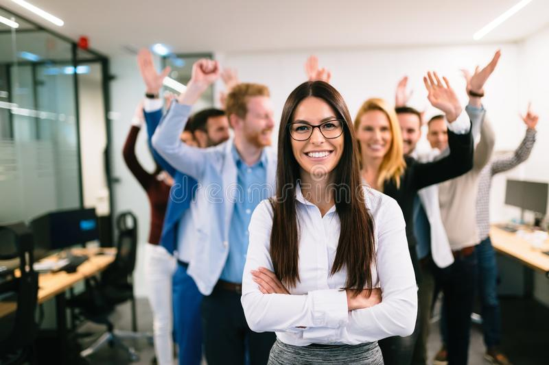 Portrait of business team posing in office stock images