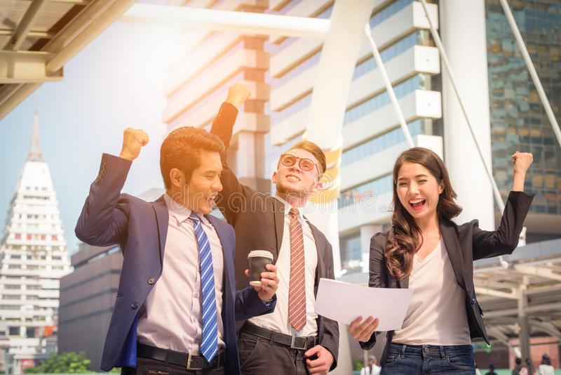 Portrait of Business team raising arms celebrate on blurred city royalty free stock images