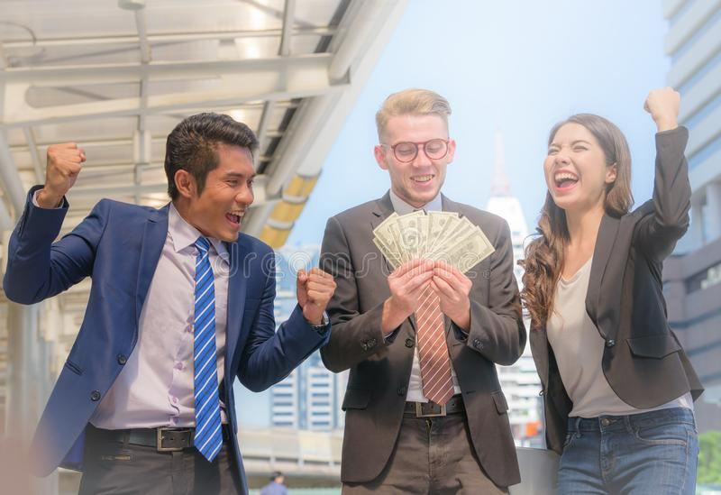 Portrait of Business team raising arms celebrate on blurred city stock images