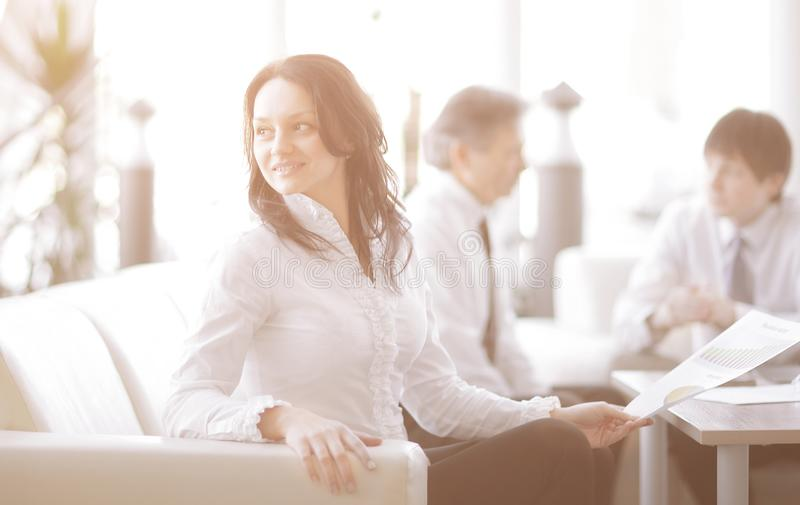 Portrait of business woman on the background of colleagues royalty free stock image