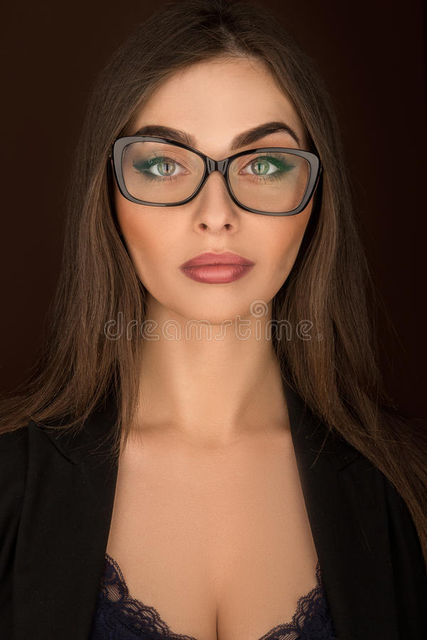 Portrait of a business woman with glasses and a black suit. On a background stock photos