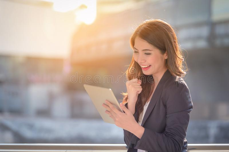 Portrait of business woman happy smile looking digital tablet on. Blurred background. Business success concept royalty free stock photos